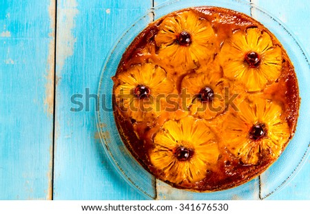 Upside down pineapple cake with caramel. - stock photo