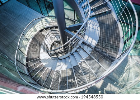 upside view of a metal spiral staircase  - stock photo
