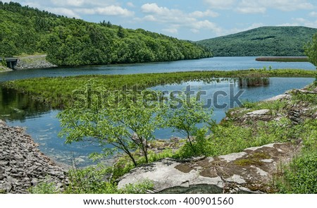 Upstate New York Reservoir:  A man-made lake in the Catskill Mountains holds water for New York City residents.  - stock photo