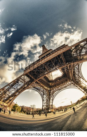 Upward fisheye view of Eiffel Tower in Paris, France - stock photo