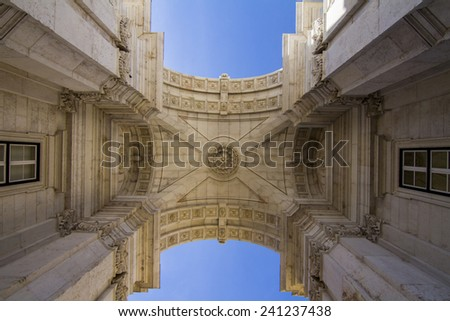 Upward view of the famous arch of the Augusta street located in Lisbon, Portugal. - stock photo