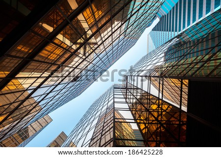Upwards perspective of glass commercial skyscrapers, Hong Kong - stock photo