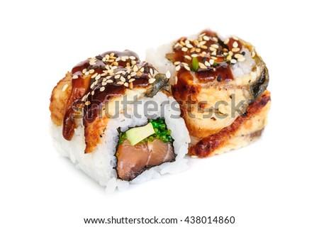 Uramaki maki sushi, two rolls isolated on white. Eeel with philadelphia, avocado, sesame and green tobico - stock photo