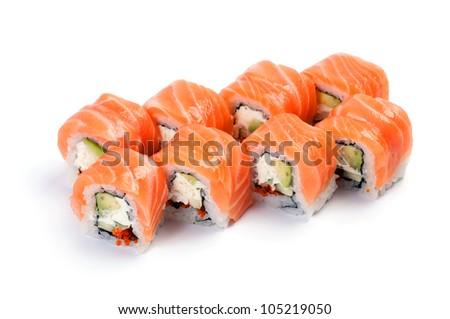 Uramaki. Philadelphia classic. Salmon, Philadelphia cheese, cucumber, avocado, tobiko - stock photo