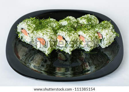 Uramaki rolls with dill, salmon, cheese, cucumber and avocado. - stock photo
