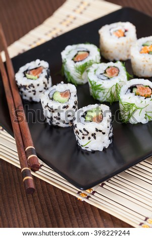Uramaki sushi set on a plate. Shallow dof