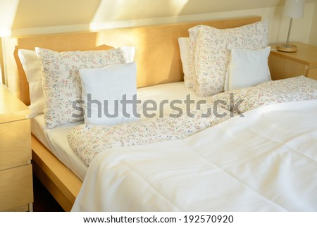 Urban apartment, bed in light bedroom  - stock photo