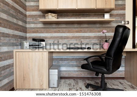 Urban apartment - modern office with a wooden desk - stock photo