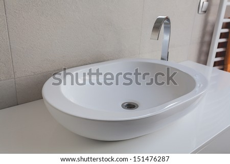 Urban apartment - modern white oval vessel sink