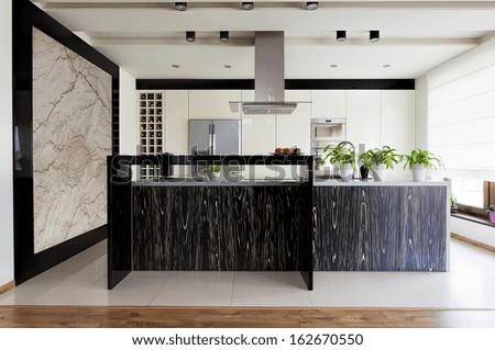 Urban apartment - original patterned kitchen furniture, horizontal - stock photo