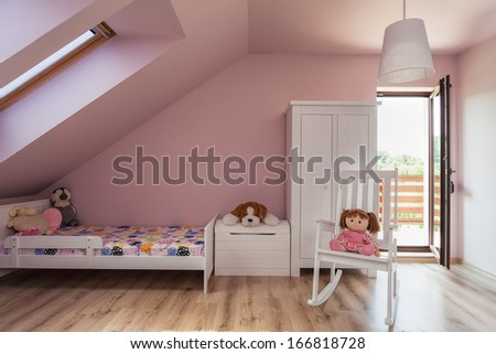 Urban apartment - pink girl's room on the attic - stock photo