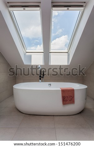 Urban apartment - vertical view of modern bath on the attic - stock photo