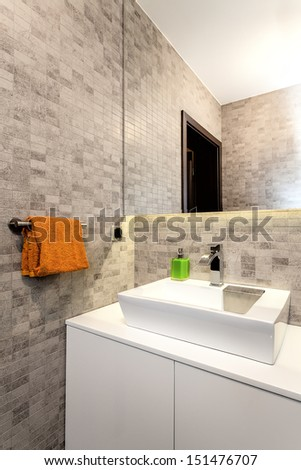 Urban apartment - White basin and counter in bathroom