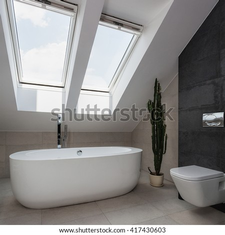 Urban apartment - white oval bath and wc in batrhoom