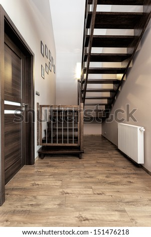 Urban apartment - wooden stairs with baby safety gate