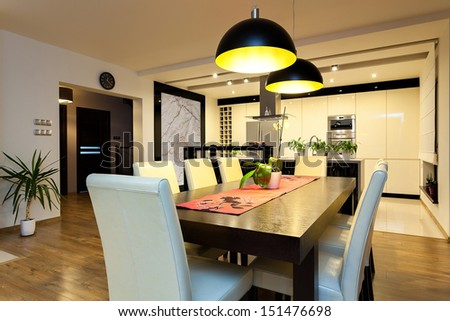 Urban apartment - Wooden table in modern dining room - stock photo