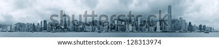 Urban architecture in Hong Kong Victoria Harbor with city skyline and cloud in the day in black and white. - stock photo