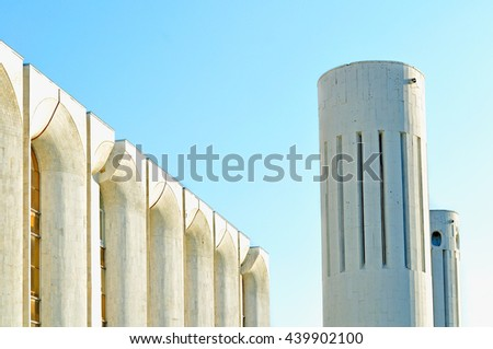Urban architecture view of concrete walls and columns built in futuristic urban style. Architecture modern background with architecture cityscape in futuristic style.