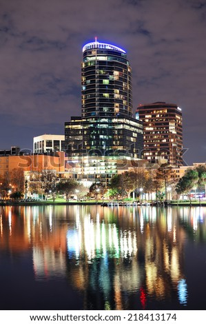 Urban architecture with Orlando downtown skyline over Lake Eola at dusk  - stock photo