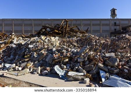 Urban Automotive Blight XV - Abandoned Automotive Factory - Worn, Broken and Forgotten - stock photo