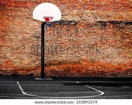 Urban basketball court in neighborhood with old buildings             - stock photo