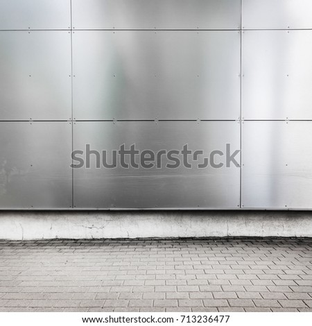 Urban building wall, modern, metallic, with sidewalk