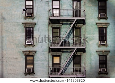 Urban Building Wall Texture with windows and Fire Escape - stock photo