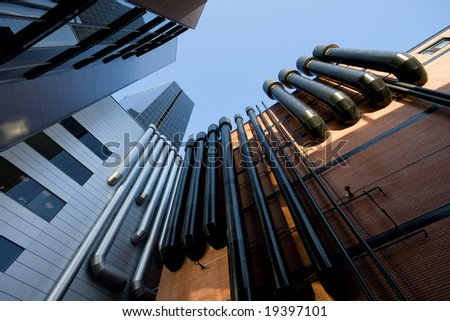 Urban buildings with tubes horizontal - stock photo