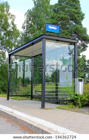 Urban bus stop shelter, space for your advertisement - stock photo