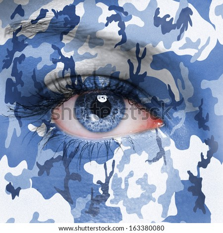 Urban camouflage on human face - stock photo
