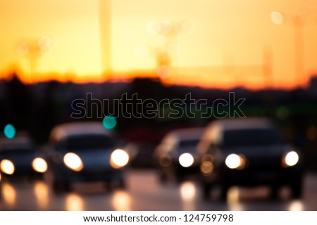 urban car traffic at dusk time- blurred abstract bokeh view - stock photo