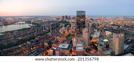 Urban city aerial panorama view. Boston aerial view with skyscrapers at sunset with city downtown skyline. - stock photo