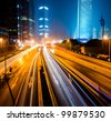 Urban city at night with traffic and night skyline, shanghai China. - stock photo