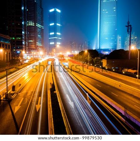 Urban city at night with traffic and night skyline, shanghai China. - stock photo