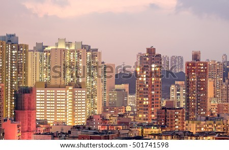 urban city at sunset with all lights lit up