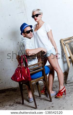 urban couple, man and woman posing - stock photo