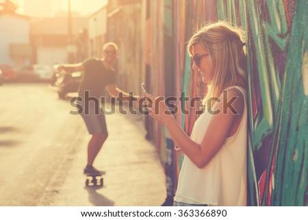 Urban couple outdoors. - stock photo