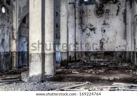 Urban decay, old gold smelting factory interior with pillars - stock photo