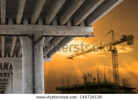 urban development by big crane building construction  with beautiful sky in evening scene - stock photo