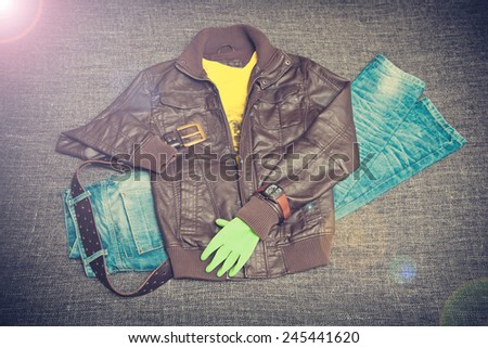urban fashion: leather jacket, jeans, T-shirt, belt, watch. vintage style - stock photo