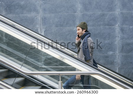 urban fashion man walking in the city street - stock photo