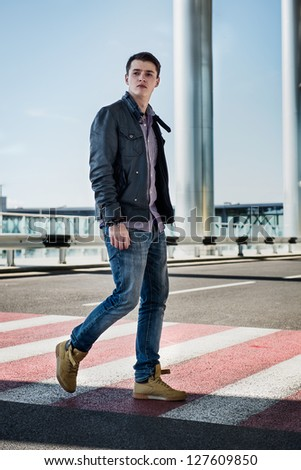 Urban fashion man walking thought crosswalk - stock photo
