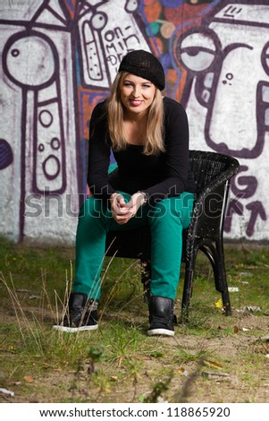 Urban fashion portrait of pretty girl with long blonde hair.