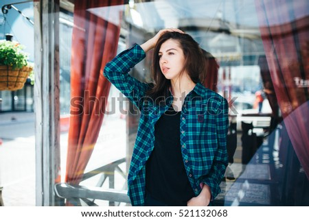 Urban fashionable girl posing outdoors in the city