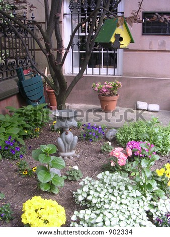 urban garden with birdhouse in brooklyn heights
