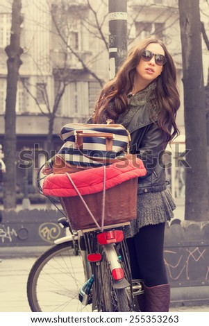 Urban girl with a bicycle.