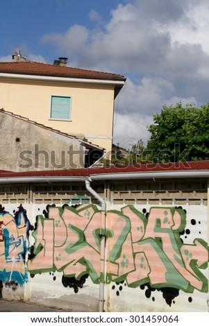 urban graffiti on a wall - stock photo