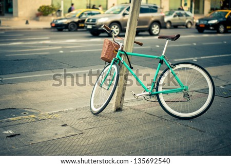 Urban green Bicycle parked in the street - stock photo