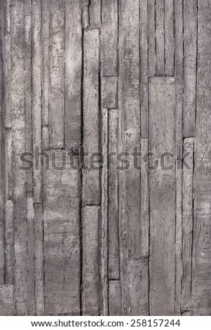 Urban grunge background, shabby wall with paint and plaster cracks vertical - stock photo