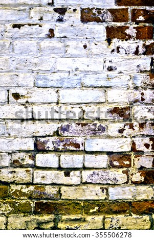 Urban grunge: Detail of whitewashed exterior brick wall, with filtered effects, for texture and background (ninth in a series of eleven) - stock photo